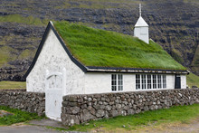 White church with turf roof