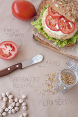 Fresh vegan sandwich with garbanzo beans, tomato and salad