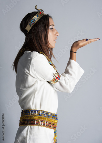 Young girl posing in egyptian clothing