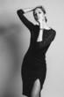 beautiful woman model posing in elegant dress in the studio