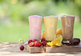 Three fruit or choclate smoothies or milkshakes