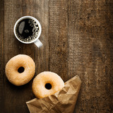 Sugared ring doughnut with espresso coffee