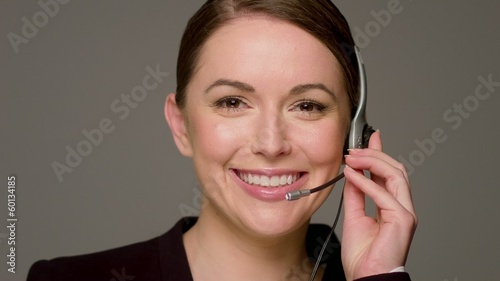 Beautiful Female Call Center Operator Talking And Smiling