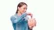 Young Casual Dressed Woman Put Banknote Into Piggy Bank