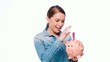 Pretty Girl Put Banknote Into Piggy Bank