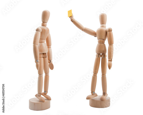 Wooden referee shows yellow card to player