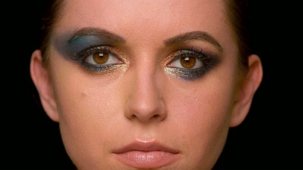 Woman With Dark Colorful Makeup