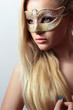 Beautiful Blond Woman in a Carnival Mask.Masquerade. Sexy Girl