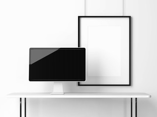 Computer monitor on a white table and blank frame