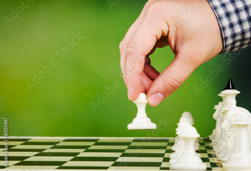 man plays chess