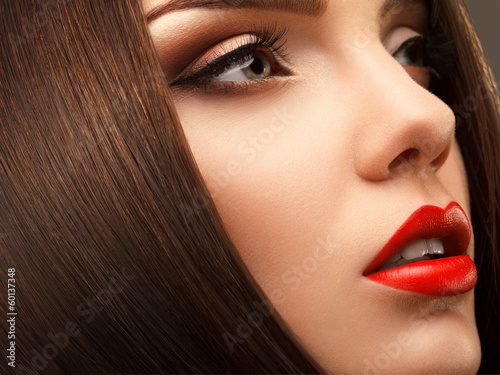 Poster Woman Eye with Beautiful Makeup. Red Lips. High quality image.