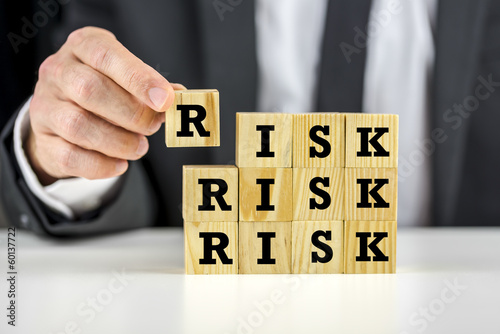 Man stacking wooden risk blocks