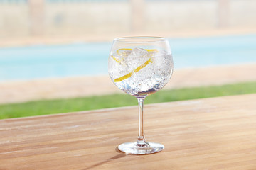 Gin and tonic cocktail on poolside