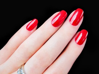 Beautiful pretty womans hand fingers sexy red fingernails nails
