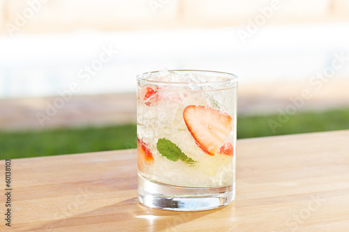 Strawberry mojito cocktail by a pool outdoors