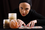 young woman with divination cards