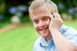 Handicapped boy talking on cell phone. - 60139398