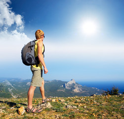 Tourist on the mountain top. Active life concept
