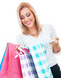 Surprised blond woman holding shopping bags