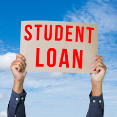 Man hand holding paper with student loan word