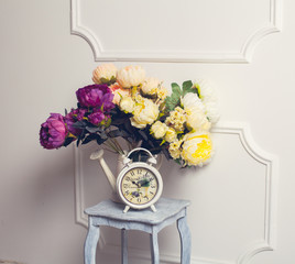 Old fashion alarm clock with peonies