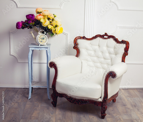 clock, chair and bouquet of flowers