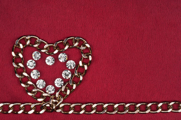 Symbol of heart from the chain and rhinestones