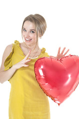 Funny woman holding red heart balloon over white background. Val
