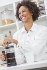 Mixed Race African American Girl Making Coffee