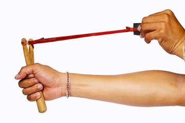 Hand Pulling Slingshot on White Background