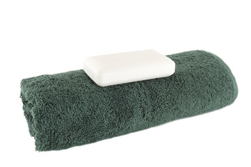 green towel with a piece of soap