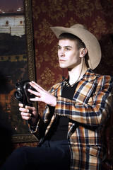 Portrait of young man with old cinema camera in hand