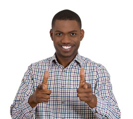Young handsome smiling man pointing at you with two fingers