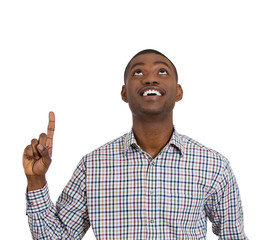 Excited young man pointing up, having a solution