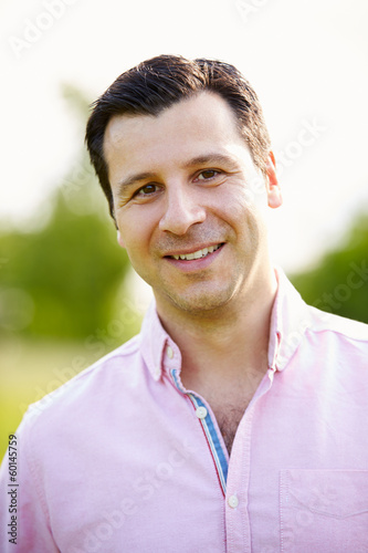 Portrait Of Smiling Hispanic Man In Countryside