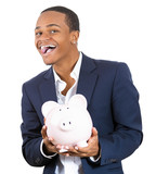 Excited young business man holding a piggy bank