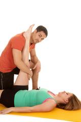 man kneel stretch womans leg