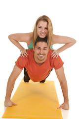 man pushup woman on back smiles