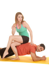 man pushup woman sit on back look side