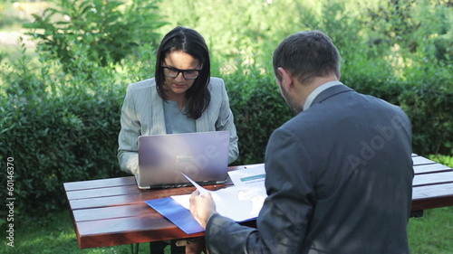 business couple working in the garden