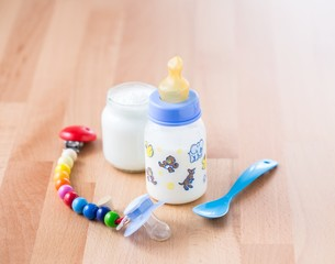 Pacifier, baby milk and yoghurt