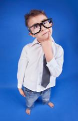 Six years thoughtful boy wearing geek glasses