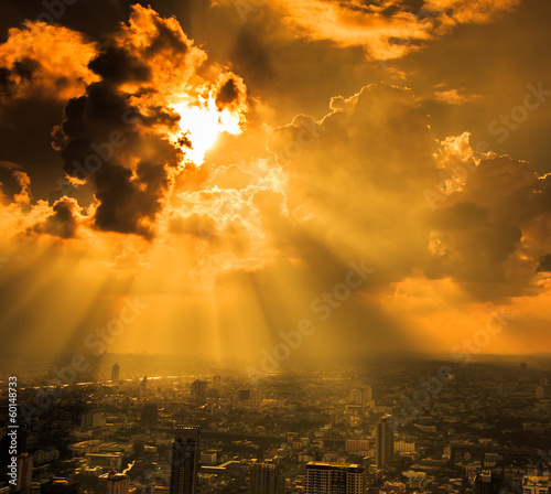 Rays of light shining through dark cloud