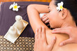 Indonesian Asian woman at wellness spa massage