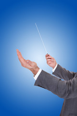 Person Directing With A Conductor's Baton