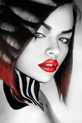 Desaturated portrait of sexy caucasian woman with red lips