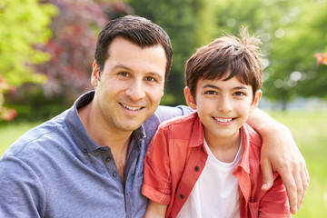 Portrait Of Hispanic Father And Son In Countryside