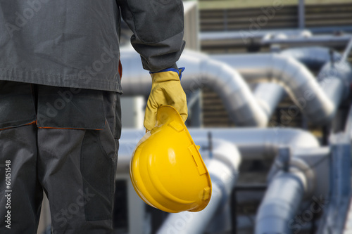 worker with helmet in front of production hall - 60151548