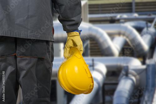 Leinwanddruck Bild worker with helmet in front of production hall