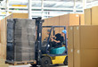 canvas print picture - Gabelstaplerfahrer in d. Logistik // logistics shipping